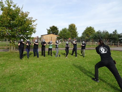 The Marshal of the Academy of Steel demonstrating a stance while participants in a taster session copy him.