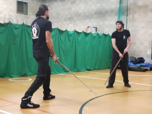 Two academy members facing off against each other with longswords.