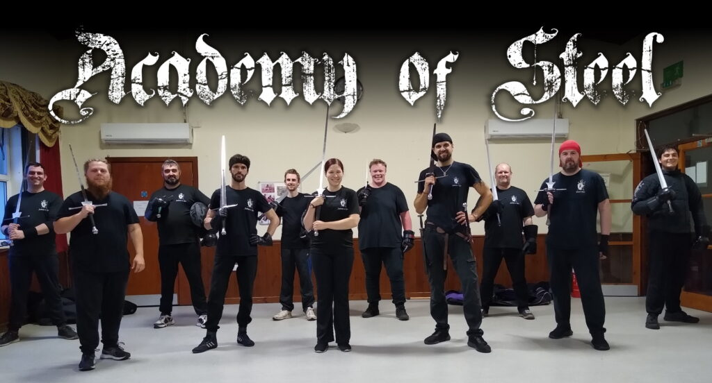 Members of the Academy of Steel lined up with longswords.